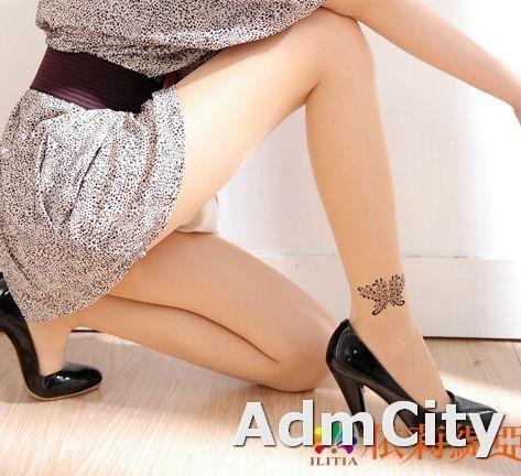 蝴蝶刺青形透明超彈性纖維褲襪.適合身高140到160公分.體重35公斤到45公斤.腰圍:21英吋到25英吋.